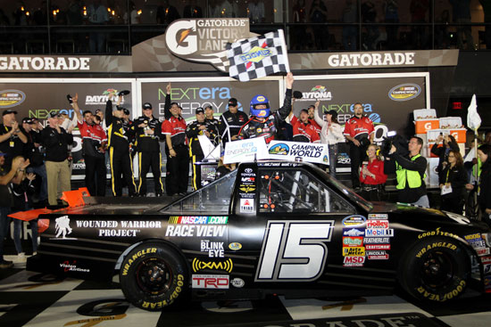 Michael Waltrip celebrates in victory lane with his No.15 crew after winning the 2011 NextEra Energy Resources 250 at Daytona International Speedway in Daytona Beach, Fla. (Credit: Jerry Markland/Getty Images for NASCAR)