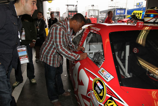 The Baltimore Raven's Ray Rice visits the NASCAR Sprint Cup Series garage and takes a look in the No. 42 Target Chevrolet Wednesday at Daytona International Speedway in Daytona Beach, Fla. (Credit: Motorsports Images and Archives)