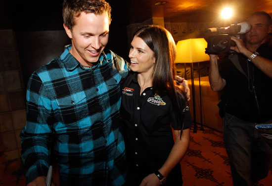 "Daytona 500 champion Trevor Bayne is congratulated by NASCAR driver Danica Patrick on Thursday in Phoenix, Ariz. Bayne and Patrick made a special appearance at Phoenix International Raceway's annual ""Night of Champions"" charity event. (Credit: Tom Pennington/Getty Images for Phoenix International Raceway)"