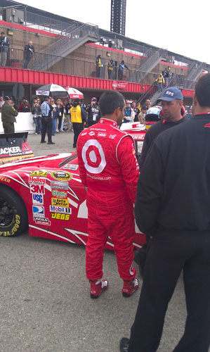 Juan Pablo Montoya waits for practice to begin. He was the only driver I could see that wasn't sitting in their car, seemed like a good idea considering they didn't get going for awhile.