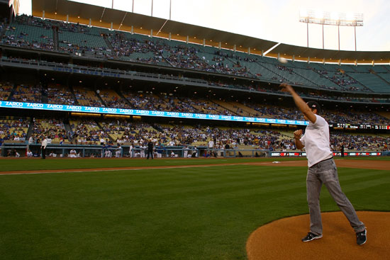 Marco Andretti throws out the first pitch for the Los Angeles Dodgers vs. St. Louis Cardinals game on Friday, April 15, 2011