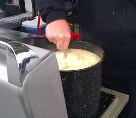 Scalloped potatoes being prepared at the No. 21 Motorcraft/Quick Lane Ford hauler