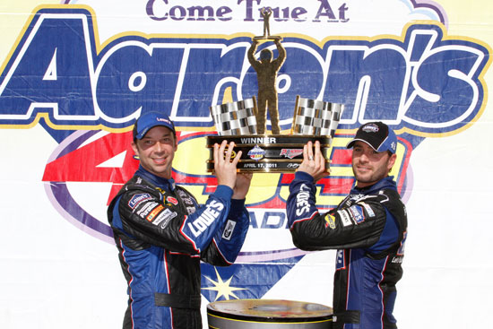 Crew chief Chad Knaus and Jimmie Johnson, driver of the No. 48 Lowe's Chevrolet, celebrate in Victory Lane at Talladega.