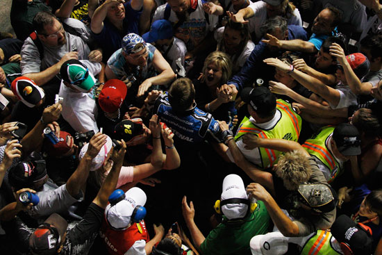 Carl Edwards joins the fans following his win in the NASCAR Nationwide Series 15th Annual O'Reilly Auto Parts 300 at Texas Motor Speedway in Fort Worth, Texas. (Credit: Chris Graythen/Getty Images)