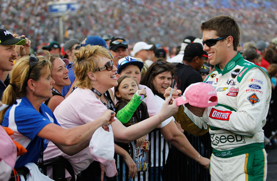 Going for a weekend sweep, Carl Edwards greets fans prior to the NASCAR Sprint Cup Series Samsung Mobile 500 at Texas Motor Speedway on Saturday in Fort Worth, Texas. (Credit: Tom Pennington/Getty Images for NASCAR)