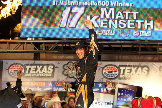 Matt Kenseth celebrates in Victory Lane after winning the NASCAR Sprint Cup Series Samsung Mobile 500 at Texas Motor Speedway on Saturday in Fort Worth, Texas. (Credit: Tom Pennington/Getty Images for NASCAR)