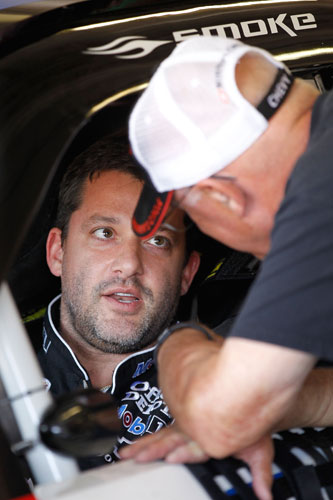 Tony Stewart, driver of the No. 14 Mobil 1/Office Depot Chevrolet, talks his father, Nelson, during practice for the NASCAR Sprint Cup Series Samsung Mobile 500 at Texas Motor Speedway on Apr. 7 in Fort Worth, Texas. (Credit: Matthew Stockman/Getty Images)