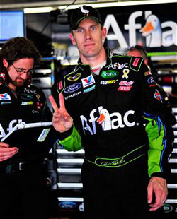 Carl Edwards, driver of the #99 AFLAC Ford, gestures in the garage area, after practice for the NASCAR Sprint All-Star Race at Charlotte Motor Speedway on May 20, 2011 in Charlotte, North Carolina. (Photo by Jason Smith/Getty Images for NASCAR)