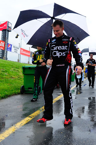 NASCAR Nationwide Series driver Jason Leffler splashes a puddle as he waits through over an hour rain delay before the start of the 5-hour Energy 200 on Saturday at Dover International Speedway in Dover, Del. (Credit: Jason Smith/Getty Images for NASCAR)