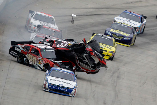 Carl Edwards leads as Joey Logano (No. 20) collides with Clint Bowyer (No. 33) at the end of the NASCAR Nationwide Series 5-hour Energy 200 on Saturday at Dover International Speedway in Dover, Del. (Credit: Todd Warshaw/Getty Images for NASCAR)
