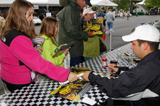 Reed Sorenson meets young fans on Saturday morning during a NASCAR Nationwide Series autograph session at the official NASCAR Merchandise Hauler at Dover International Speedway in Dover, Del. (Credit: Todd Warshaw/Getty Images for NASCAR)