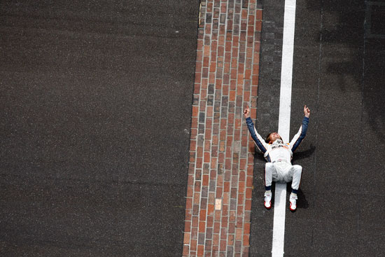 Dan Wheldon lays down on the finish line