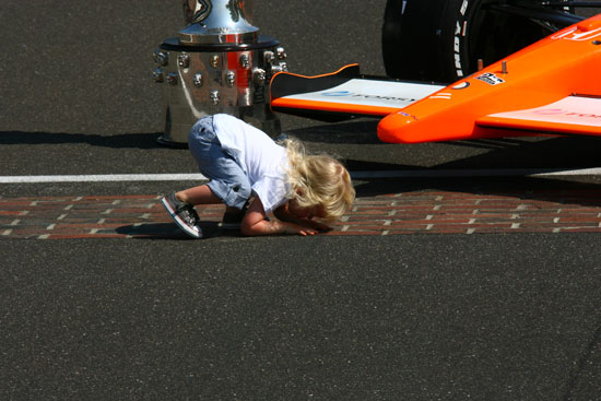 Sebastian Wheldon kisses the bricks! So cute!