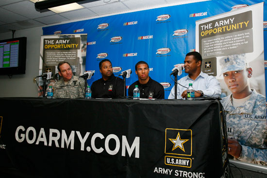 (L-R) Lt. Gen. Benjamin C. Freakley, commander of the U.S. Army Accessions Command, Revolution Racing CEO Max Siegel, Darrell Wallace Jr and NASCAR Vice President of Public Affairs and Multicultural Development announce a partnership between the U.S. Army and Revolution Racing. (Credit: John Harrelson/Getty Images for NASCAR)