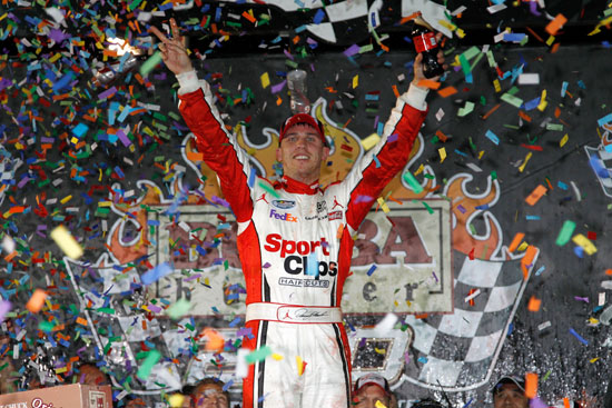 Denny Hamlin celebrates winning the BUBBA Burger 250 at Richmond International Raceway, his second NASCAR Nationwide Series victory at his home track. (Credit: Todd Warshaw/Getty Images for NASCAR)