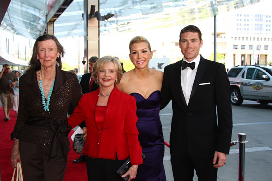 Indianapolis Motor Speedway chairman Mari Hulman George arrives with Florence Henderson, and Mari's grandson Jarrod Krisiloff and his wife, Megan.