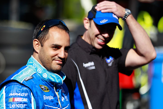 Juan Pablo Montoya shares a laugh with No. 48 crew chief Chad Knaus during NASCAR Sprint Cup Series practice on Saturday at Infineon Raceway in Sonoma, Calif. (Credit: Chris Graythen/Getty Images)