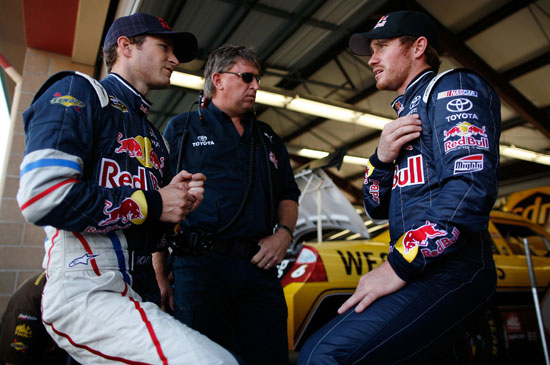 (Left to right) Kasey Kahne listens to No. 83 crew chief Ryan Pemberton and driver Brian Vickers during a Red Bull Racing garage powwow during NASCAR Sprint Cup Series practice Saturday at Infineon Raceway in Sonoma, Calif. (Credit: Tom Pennington/Getty Images)