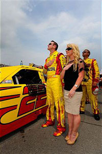 Kurt Busch, driver of the #22 Shell/Pennzoil Dodge, stands with Patricia Driscoll prior to the NASCAR Sprint Cup Series Heluva Good! Sour Cream Dips 400 at Michigan International Speedway on June 19, 2011 in Brooklyn, Michigan. (Photo by Jason Smith/Getty Images for NASCAR)