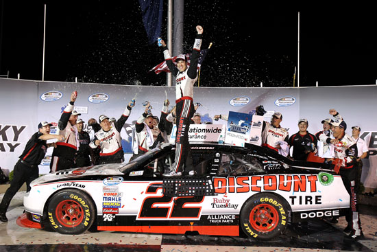 Brad Keselowski and the No. 22 Discount Tire team celebrate winning the Feed the Children 300 at Kentucky Speedway  (Credit: Tom Whitmore/Getty Images for NASCAR)