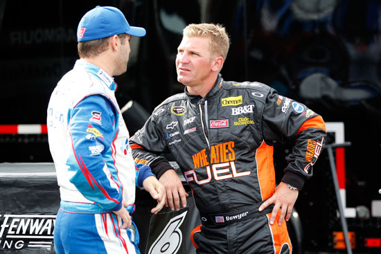 Clint Bowyer and Elliott Sadler talk shop before NASCAR Nationwide Series practice on Thursday at Daytona International Speedway. (Credit: Geoff Burke, Getty Images for NASCAR)