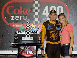 David Ragan, driver of the #6 UPS Ford, poses with the trophy and his girlfriend, Jacquelyn Butler, after winning the NASCAR Sprint Cup Series Coke ZERO 400 Powered by Coca-Cola at Daytona International Speedway on July 2, 2011 in Daytona Beach, Florida. (Photo by Jared C. Tilton/Getty Images)