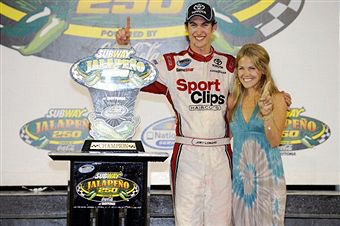 Joey Logano, driver of the #20 Sport Clips Toyota, celebrates with his girlfriend, Sabrina Simpson, after winning the NASCAR Nationwide Series Subway Jalapeno 250 Powered by Coca-Cola at Daytona International Speedway on July 1, 2011 in Daytona Beach, Florida. (Photo by Jared C. Tilton/Getty Images)