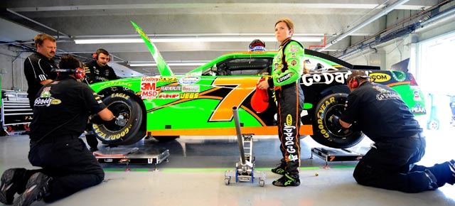 Danica Patrick stands beside the No. 7 GoDaddy.com Chevrolet as crew members work in the garage area, during practice for the NASCAR Nationwide Series NAPA Auto Parts 200 at Circuit Gilles Villeneuve on Aug. 19 in Montreal, Canada. (Credit: Jason Smith/Getty Images)