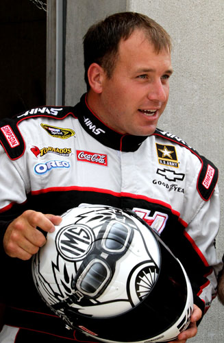 Ryan Newman, driver of the No. 39 Haas Automation Chevrolet, inspects his helmet during practice for the NASCAR Sprint Cup Series Brickyard 400 at Indianapolis Motor Speedway on July 29 in Indianapolis, Ind. (Credit: Jerry Markland/Getty Images for NASCAR)