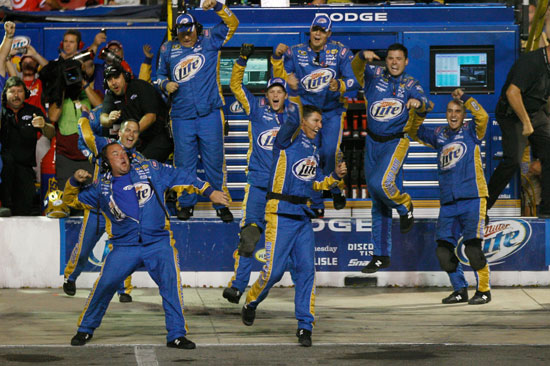 The No. 2 Penske Racing crew celebrates its third win of the season as Brad Keselowski crosses the finish line first in the NASCAR Sprint Cup Series Irwin Tools Night Race at Bristol Motor Speedway on Saturday. (Credit: Chris Graythen/Getty Images)