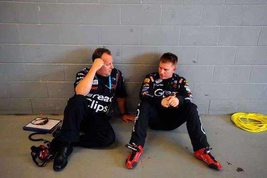 Jason Leffler (right), driver of the No. 38 Great Clips Toyota, speaks with crew chief Eddie Pardue (left) in the garage area during practice for the NASCAR Nationwide Series U.S. Cellular 250 at Iowa Speedway on Aug. 5 in Newton, Iowa. (Credit: Jason Smith/Getty Images for NASCAR)