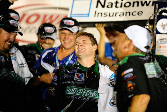 Ricky Stenhouse Jr. (center), driver of the No. 6 RickyvsTrevor.com Ford, celebrates with crew members in Victory Lane after winning the NASCAR Nationwide Series U.S. Cellular 250 at Iowa Speedway on Aug. 6 in Newton, Iowa. (Credit: Jason Smith/Getty Images for NASCAR)