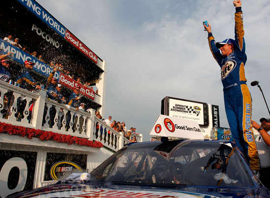 Brad Keselowski, driver of the No. 2 Miller Lite Dodge, celebrates in Victory Lane after winning the NASCAR Sprint Cup Series Good Sam RV Insurance 500 at Pocono Raceway on Aug. 7 in Long Pond, Pa. (Credit: Geoff Burke/Getty Images for NASCAR)