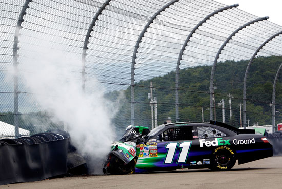 Denny Hamlin crashes the No. 11 FedEx Ground Toyota into the tire barrier after an incident in the NASCAR Sprint Cup Series Heluva Good! Sour Cream Dips at the Glen at Watkins Glen International on Aug. 15 in Watkins Glen, N.Y. (Credit: Jeff Zelevansky/Getty Images for NASCAR)