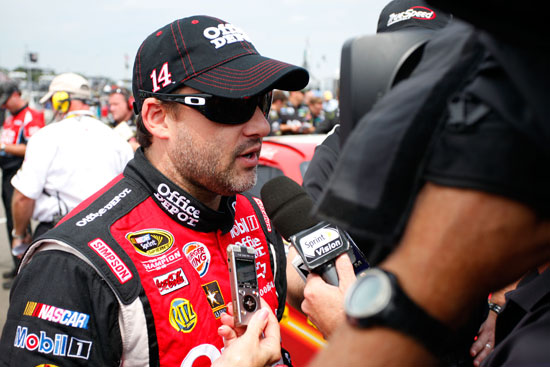 Tony Stewart, driver of the No. 14 Office Depot/Mobil 1 Chevrolet, speaks to the media on the grid after qualifying for the NASCAR Sprint Cup Series Heluva Good! Sour Cream Dips at the Glen at Watkins Glen International on Aug. 13 in Watkins Glen, N.Y. (Credit: Jeff Zelevansky/Getty Images for NASCAR)