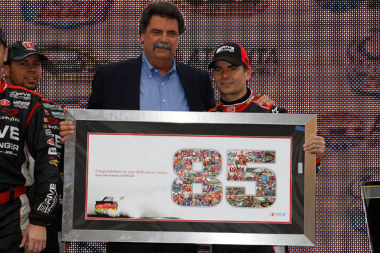 NASCAR President Mike Helton presents a plaque to Jeff Gordon commemorating his 85th win in the NASCAR Sprint Cup Series AdvoCare 500 at Atlanta Motor Speedway on Sept. 6 in Hampton, Ga. (Credit: Chris Graythen/Getty Images)