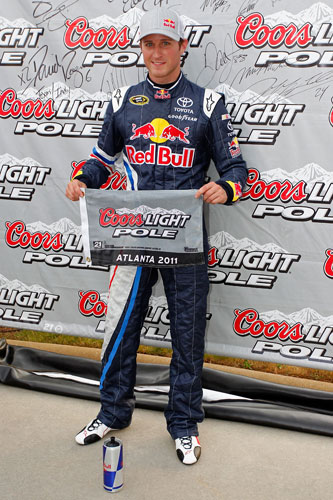 Kasey Kahne, driver of the No. 4 Red Bull Toyota, poses with the Coors Light Pole banner after setting the pole position of 186.196 mph (29.775 secs.) in qualifying for the NASCAR Sprint Cup Series AdvoCare 500 at Atlanta Motor Speedway on Sept. 3 in Hampton, Ga. (Credit: Geoff Burke/Getty Images for NASCAR)