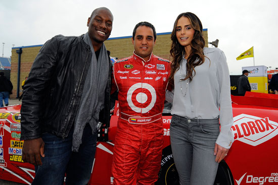 (Left to right) Actor Tyrese Gibson, NASCAR Sprint Cup Series driver Juan Pablo Montoya and actress Jordana Brewster pose for a photograph in the garage area prior to practice for the NASCAR Sprint Cup Series GEICO 400 at Chicagoland Speedway on Sept. 16 in Joliet, Ill. (Credit: Jason Smith/Getty Images)