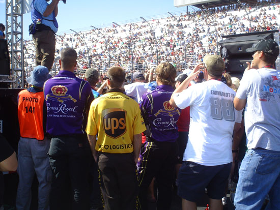 Pit crew guys watch the Montgomery Gentry show