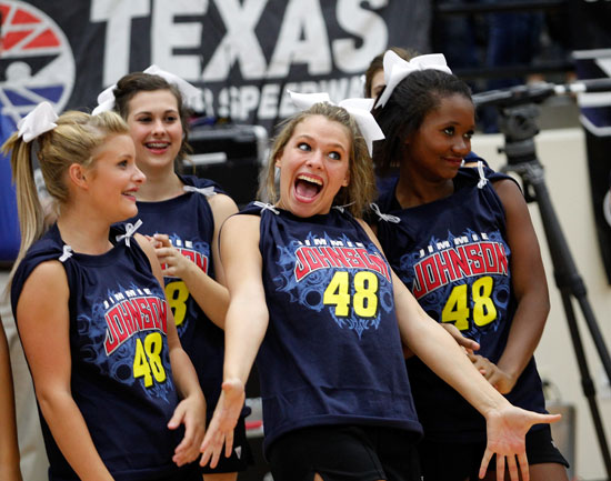 Byron Nelson High School cheerleaders react after seeing five-time NASCAR Sprint Cup Series champion Jimmie Johnson during a Texas football-style pep rally at Byron Nelson High School on Wednesday in Trophy Club, Texas. (Credit: Tom Pennington/Getty Images for Texas Motor Speedway)
