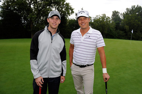 Denny Hamlin, (L), NASCAR Sprint Cup Series driver of the No. 11 Joe Gibbs Racing FedEx Toyota Camry, and playing partner Fredrik Jacobson, (R), of Sweden pose for a photo during the Pro-Am round for the BMW Championship at Cog Hill Golf & Country Club on Wednesday in Lemont, Ill. Hamlin is in town for the Chase for the NASCAR Sprint Cup, which begins this weekend at Chicagoland Speedway in Joliet, Ill. (Credit: Stan Badz/PGA TOUR)