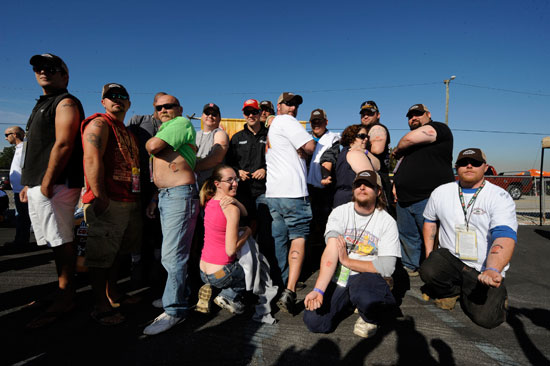 Adult fans show NASCAR star Matt Kenseth their tattoos featuring his signature, number 17 and Jeremiah Weed malt beverage cans.