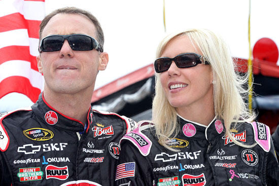 Kevin and DeLana Harvick stand on pit road before the start of the NASCAR Sprint Cup Series AAA 400 on Sunday at Dover International Speedway in Dover, Del. Kevin would end the day with the points lead in the Chase for the NASCAR Sprint Cup. (Credit: Tom Whitmore/Getty Images for NASCAR)