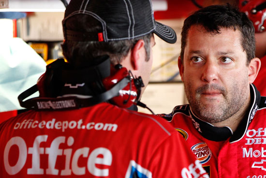 NASCAR Sprint Cup Series points leader Tony Stewart (right), driver of the No. 14 Office Depot/Mobil 1 Chevrolet, talks over strategy with crew chief Darian Grubb (left) during practice for the NASCAR Sprint Cup Series AAA 400 at Dover International Speedway on Sept. 30 in Dover, Del. (Credit: Geoff Burke/Getty Images)