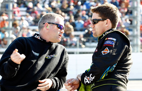 No. 99 crew chief Bob Osborne and driver Carl Edwards talk before the NASCAR Sprint Cup Series TUMS Fast Relief 500 at Martinsville Speedway on Sunday. (Credit: Jeff Zelevansky/Getty Images for NASCAR)
