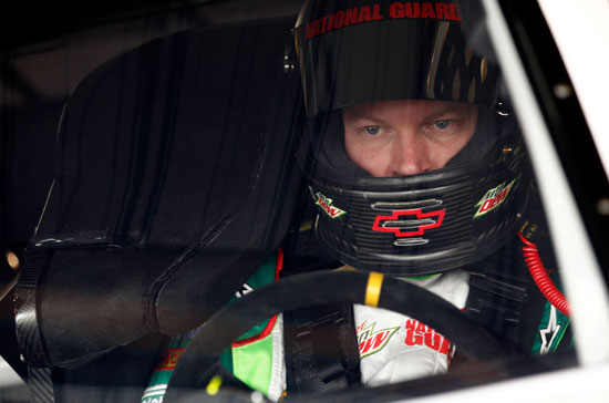 Dale Earnhardt Jr. sits in the cockpit during the one NASCAR Sprint Cup Series practice of the weekend on Saturday at Martinsville Speedway. With a 95.554 mph/19.817 seconds lap, Earnhardt Jr. was the third-fastest Chase for the NASCAR Sprint Cup Series driver in the session. (Credit: Jeff Zelevansky/Getty Images for NASCAR)