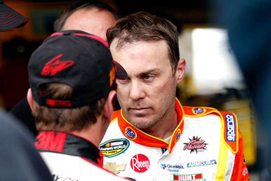 (Left to right) NASCAR Sprint Cup Series drivers Greg Biffle and Kevin Harvick talk in the garage after the two drivers made contact on the track during practice on Saturday at Martinsville Speedway. (Credit: Geoff Burke/Getty Images for NASCAR)