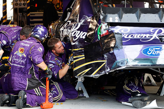 The No. 17 Roush Fenway Racing team works on Matt Kenseth's car in the garage late in the NASCAR Sprint Cup Series TUMS Fast Relief 500 at Martinsville Speedway on Sunday as Kenseth dropped three spots in the Chase for the NASCAR Sprint Cup standings. (Credit: Geoff Burke/Getty Images for NASCAR)