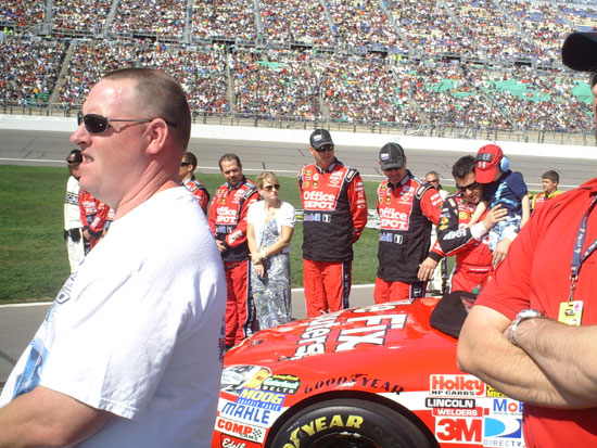 Tony Stewart plays with his crew chief, Darian Grubb's son, Gavin during the pre-race festivities at Kansas Speedway