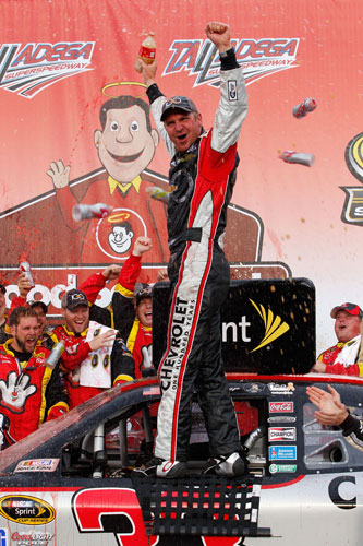 Clint Bowyer celebrates winning the Good Sam Club 500 at Talladega Superspeedway, his second straight fall win at the track. (Credit: Geoff Burke/Getty Images for NASCAR)